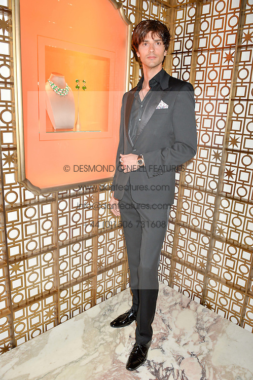 DAVID JARRE son of Charlotte Rampling at the launch of the new Bulgari flagship store at 168 New Bond Street, London on 14th April 2016.