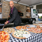 June 9, 2015, New Haven, CT:<br /> Former ATP World Tour star and Connecticut Open Legends Event Participant James Blake serves Naples Pizza to guests during a press conference at the Connecticut Tennis Center to announce the new Connecticut Open 50/50 Project and the renewal of United Technologies sponsorship of the tournament through the 2017 in New Haven, Connecticut Tuesday, June 9, 2015.<br /> (Photos by Billie Weiss/Connecticut Open)