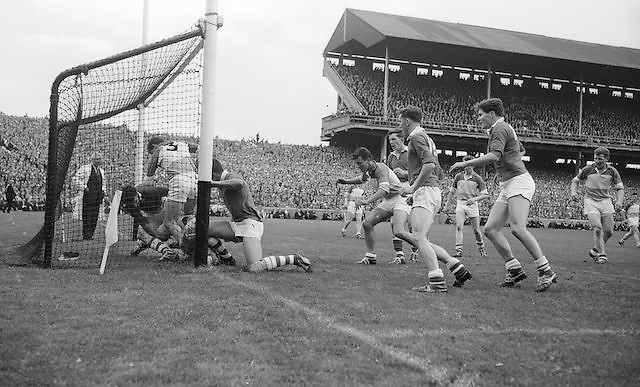 Offaly goalie M. Furlong is knocked into goal by Cork forwards but goal disallowed at the All Ireland Minor Gaelic Football final Cork V. Offaly in Croke Park on 27th September 1964.