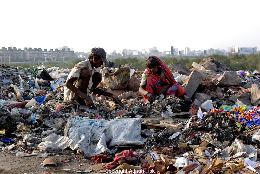 On the edge of Dharavi slum dwellers sift through waste looking for anything they can sell on 21st Oct 2006.