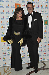 © Licensed to London News Pictures. 30/09/2017. London, UK. DAME JOAN COLLINS and PERCY GIBSON attends The Shooting Stars Chase Ball at the Dorchester Hotel. The leading children's hospice cares for babies, children and young people with life-limiting conditions, and their families. The Ball is the charity's flagship event and hopes to raise in excess of £100,000 to provide nursing, medical and emotional support to families going through unimaginable circumstances. Photo credit: Ray Tang/LNP