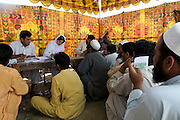 Residents from SWAT valley begin arriving and registering at Shaik Shazad IDP camp at outside of Mardan in North West Frontier Province...Within four days more than 2000 families have reportedly registered as IDP's seeking shelter and food at the hastily arranged camp. According to UNHCR Some 500,000 residents have fled SWAT and neighboring provinces since August 2008. On Thursday the Pakistan Government announced a military operation to 'eliminate' Taliban militants form the SWAT Valley. A further 1 million IDP's are expected in the coming weeks as the military advances throughout SWAT valley towards achieving their military goals..