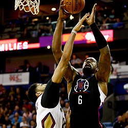 Dec 28, 2016; New Orleans, LA, USA;  Los Angeles Clippers center DeAndre Jordan (6) shoots over New Orleans Pelicans forward Anthony Davis (23) during the first quarter of a game at the Smoothie King Center. Mandatory Credit: Derick E. Hingle-USA TODAY Sports