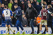 Lewis Dunk (Capt) (Brighton) leads Neal Maupay (Brighton) away and towards the tunnel following an altercation between Neal Maupay (Brighton) & Ezri Konsa (Aston Villa) as both players went to leave the pitch following the final whistle after the Premier League match between Brighton and Hove Albion and Aston Villa at the American Express Community Stadium, Brighton and Hove, England on 18 January 2020.