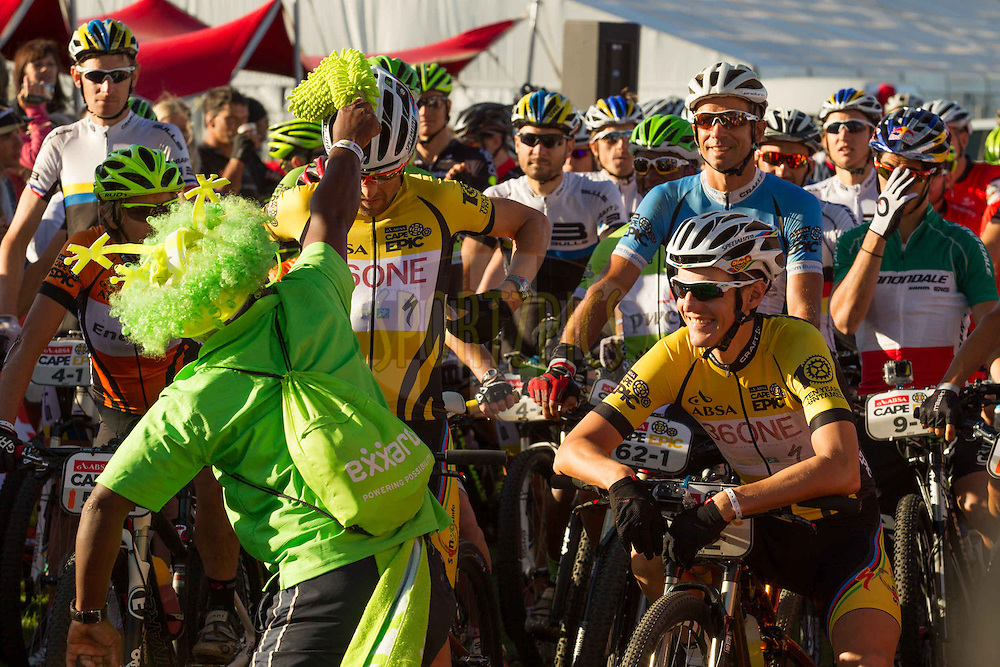 The Exxaro praise singer blesses the yellow jersey Burry Stander SONGO team of Christoph Sauser and Jaroslav Kulhavy at the start of the final stage (stage 7) of the 2013 Absa Cape Epic Mountain Bike stage race from Stellenbosch to Lourensford Wine Estate in Somerset West, South Africa on the 24 March 2013..Photo by Greg Beadle/Cape Epic/SPORTZPICS