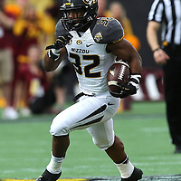 ORLANDO, FL - JANUARY 01:  Russell Hansbrough #32 of the Missouri Tigers runs the football during the Buffalo Wild Wings Citrus Bowl between the Minnesota Golden Gophers and the Missouri Tigers at the Florida Citrus Bowl on January 1, 2015 in Orlando, Florida. (Photo by Alex Menendez/Getty Images) *** Local Caption *** Russell Hansbrough
