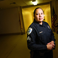 Sargent Melanie Begay poses for a portrait at the Gallup Police Department Wednesday.  Begay has been on the force more than 15 years.
