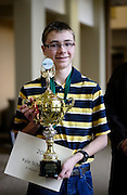 Kyle Schroeder, a 14-year-old student from St. Brendon School, holds his trophy after being announced the Columbus Metro Regional Spelling Bee winner, Saturday, March 16, 2013. Schroeder and Matthew Pitcock, the Southeastern Ohio region spelling bee winner, will be attending the Scripps National Spelling Bee held near Washington, D.C from May 28-30, 2013.