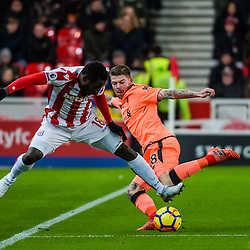 Stoke City forward Mame Biram Diouf (18) and Liverpool defender Alberto Moreno (18) during the Premier League match between Stoke City and Liverpool<br /> (c) John Baguley | SportPix.org.uk