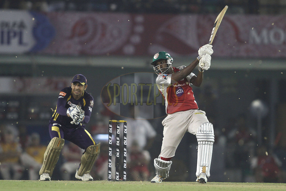 Dimitri Mascarenhas of the Kings XI Punjab attacks a delivery during match 22 of the the Indian Premier League ( IPL) 2012  between The Kings X1 Punjab and The Kolkata Knightriders held at the Punjab Cricket Association Stadium, Mohali on the 18th April 2012..Photo by Shaun Roy/IPL/SPORTZPICS.