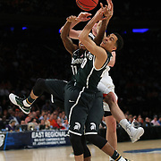Travis Trice, (front), Michigan State, and team mate Keith Appling challenge for a rebound during the Virginia Cavaliers Vs Michigan State Spartans basketball game during the 2014 NCAA Division 1 Men's Basketball Championship, East Regional at Madison Square Garden, New York, USA. 28th March 2014. Photo Tim Clayton