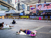 13 JANUARY 2014 - BANGKOK, THAILAND:  Anti-government protestors sleep in front of the main stage at the Silom intersection in Bangkok. The stage in the Silom intersection has been designated the main stage for Shutdown Bangkok.   PHOTO BY JACK KURTZ