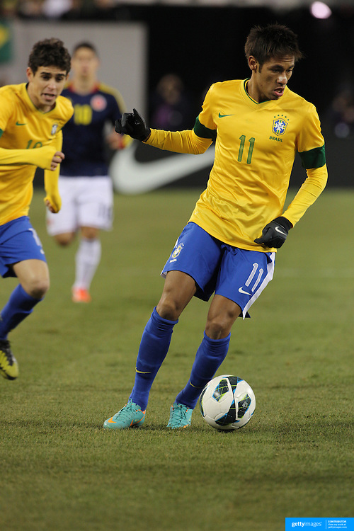 Neymar, (right) and Oscar, Brazil, in action during the Brazil V Colombia International friendly football match at MetLife Stadium, New Jersey. USA. 14th November 2012. Photo Tim Clayton