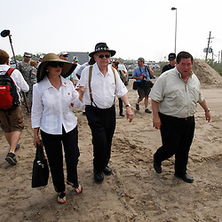 June 8, 2010; Buras, LA, USA; New Orleans Saints owner Tom Benson and his wife Gayle walk with Plaquemines Parish President Billy Nungesser to a bird rehab center stationed at Fort Jackson to clean oil impacted birds. The entire team held a rally at Fort Jackson and visited with members of the small Plaquemines Parish fishing community of Buras that has been impacted by the oil spill. (Photographer: Derick E. Hingle).