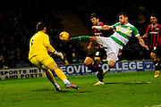 Yeovil Town's Jakub Sokolik clears the ball wide of his post under pressure fron Oxford Utd's Liam Sercombe during the Sky Bet League 2 match between Yeovil Town and Oxford United at Huish Park, Yeovil, England on 28 December 2015. Photo by Graham Hunt.