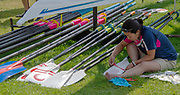 Lucerne, SWITZERLAND, 12th July 2018, Thursday  FISA World Cup series, No.3, Lake Rotsee, Lucerne,  Japanese, Coach sticking the International decals onto the Oar/Blades