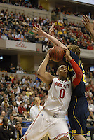 Ohio State forward Jared Sullinger (0) goes up to the basket against Michigan forward Evan Smotrycz (23) in the first half of the Big Ten Tournament semifinals in Indianapolis, on March, 11, 2011, at Conseco Fieldhouse. Ohio State defeated Michigan 68-61.
