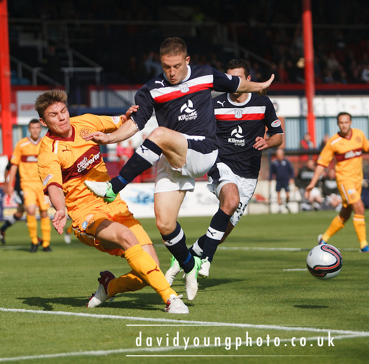 Motherwell's Shaun Hutchinson  clears from Dundee's John Baird  - Dundee v Motherwell, Clydesdale Bank Scottish Premier League at Dens Park.. - © David Young - 5 Foundry Place - Monifieth - DD5 4BB - Telephone 07765 252616 - email: davidyoungphoto@gmail.com - web: www.davidyoungphoto.co.uk