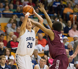 Parkersburg South center Tyler Shelton (20) shoots from the corner against Woodrow Wilson during a semi-final game at the Charleston Civic Center.