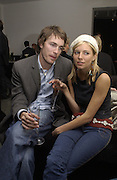 David Neville and Sienna Miller. Vertu Launch. and exhibition of work by Christopher Bucklow Serpentine. 11 April 2002. © Copyright Photograph by Dafydd Jones 66 Stockwell Park Rd. London SW9 0DA Tel 020 7733 0108 www.dafjones.com