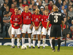 MANCHESTER, ENGLAND - Wednesday, April 23, 2003: Real Madrid's Roberto Carlos prepares to fire a free-kick as Manchester United players line up a defensive wall during the UEFA Champions League Quarter Final 2nd Leg match at Old Trafford. (Pic by David Rawcliffe/Propaganda)