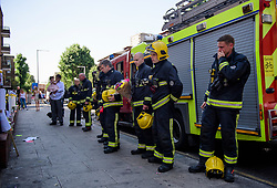 19/06/2017. London, UK. Emotional Firefighters who attended the scene of the fire, arrive to observe minutes silence held near the scene of the Grenfell tower block fire. The blaze engulfed the 27-storey building killing dozens - with 34 people still in hospital, many of whom are in critical condition. Photo credit: Ben Cawthra *** Please Use Credit from Credit Field ***