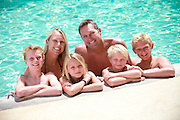 Joyful Family at the Swimming Pool
