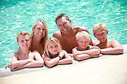 Joyful Family at the Swimming Pool