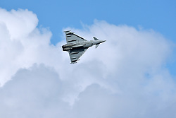 © Licensed to London News Pictures.  03/06/2017; Torbay, Devon, UK. RAF Typhoon fighter jet at the Torbay Airshow 2017. The 2017 Torbay Airshow returns this weekend on Saturday 3 and Sunday 4 June with an action packed programme of world class air displays. The world's premier aerobatic team The Red Arrows will be debuting a new routine in the first display of their season, featuring their trademark combination of close formations and precision flying. The full display programme for the weekend begins on the Saturday between 2-3pm with The Tigers Freefall Parachute Display Team, Team Raven Aerobatic Display Team, the Percival Piston Provost and the Strikemaster. From 3-4pm will be the highly anticipated display by the Red Arrows, former British Female Aerobatic Champion Lauren Richardson in her Pitts Special S1-S and world aerobatic competitor Gerald Cooper in his Xtreme XA41. Finishing off the action packed afternoon from 4-5pm will see displays from the AutoGyro, the Battle of Britain Memorial Flight aircraft, the PBY5A Catalina seaplane, The Blades and the Royal Air Force's Typhoon FGR4. Sunday afternoon will see each of the aircraft take to the skies again before the weekend closes with a final display from the RAF Chinook team. The two day show, which had its inaugural event last year, takes place on Paignton Green with the Bay providing a stunning natural amphitheatre for viewing the air displays and the perfect location for a large coastal airshow event. To stay up to date with the latest Torbay Airshow news and updates follow @torbayairshow on Facebook, Twitter and Instagram or visit www.torbayairshow.com. Picture credit : Simon Chapman/LNP