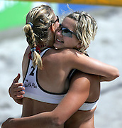 Laura Ludwig and Sara Goller (Germany) embrace after winning the NZ Beach Volleyball Open at Stanley St, Auckland, 22 January 2006. Photo: Tim Hales/PHOTOSPORT<br />