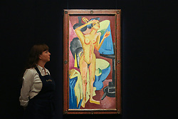 © Licensed to London News Pictures. 29/01/2020. London, UK. A staff member views Ernst Ludwig Kirchner's paining titled Nude at the Mirror (est £3m to £5m) at the preview of Sotheby's Impressionist, Modern and Surrealist art sales. The auction will take place at Sotheby's in central London on 4 and 5 February 2020. Photo credit: Dinendra Haria/LNP