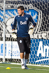 July 20, 2011; Santa Clara, CA, USA;  Vancouver Whitecaps goalkeeper Jay Nolly (18) warms up  before the game against the San Jose Earthquakes at Buck Shaw Stadium. San Jose tied Vancouver 2-2.