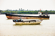 11 MARCH 2006 - MY THO, VIETNAM: Boat traffic on the Mekong River near My Tho, the capitol of Tien Giang province, on the Mekong River delta in Vietnam. The Mekong is the lifeblood of southern Vietnam. It is the country's rice bowl and has enabled Vietnam to become the second leading rice exporting country in the world (after Thailand). The Mekong delta also carries commercial and passenger traffic throughout the region.  Photo by Jack Kurtz