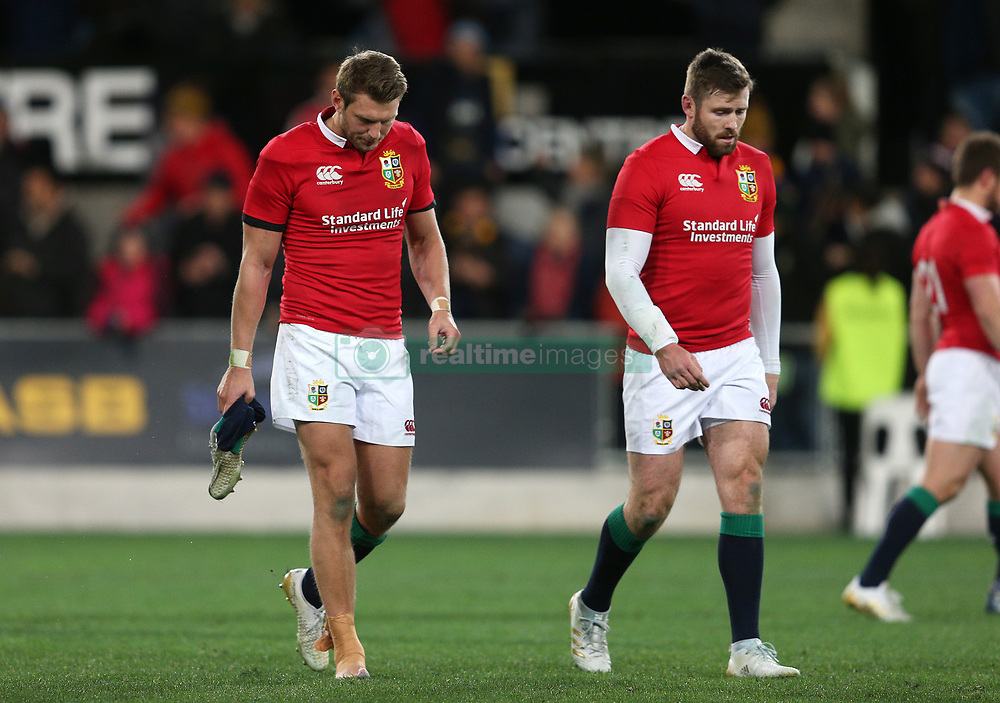 British and Irish Lions' Dan Biggar (left) and Elliot Daly appear dejected after the tour match at Forsyth Barr Stadium, Dunedin.