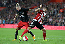 Jay Rodriguez of Southampton and Kian Hansen of FC Midtjylland challenge for the ball - Mandatory byline: Paul Terry/JMP - 07966386802 - 20/08/2015 - FOOTBALL - ST Marys Stadium -Southampton,England - Southampton v FC Midtjylland - EUROPA League Play-Off Round