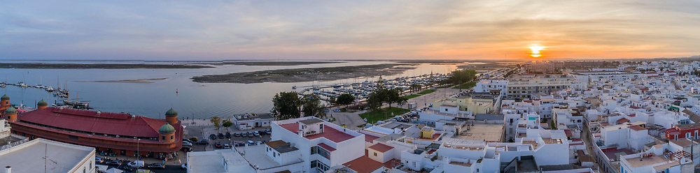 Sunset aerial cityscape in Olhao, Algarve fishing village view of ancient neighbourhood of Barreta, and its traditional cubist architecture. Portugal.