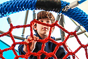 Boy of six in a playground Model released