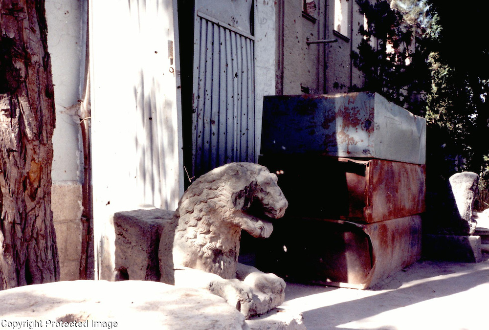 June 1995<br /> The lions guarding the entrance to the museum excavated in 1966 by the Archaeological Institute of Archaeology from Koh-i-Mori at Kam Zargar north of Kabul were badly damaged by subsequent rocket attacks. <br /> Photo: N.H.Dupree.