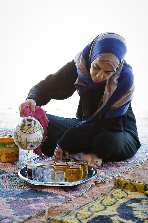 Entesar Abdullah pours Bedouin tea, in the desert outside of Marsa Matruh, Egypt.