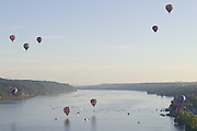July 6, 2014 - Poughkeepsie, New York, USA - <br /> <br /> Hot Air Balloons Over The Hudson<br /> <br /> People on boats and on the docks watch hot air balloons fly over the Hudson River in Poughkeepsie, New York. The balloon festival is organized by the Dutchess County Regional Chamber of Commerce. The photograph was taken from the Walkway over the Hudson.<br /> ©ZP/Exclusivepix