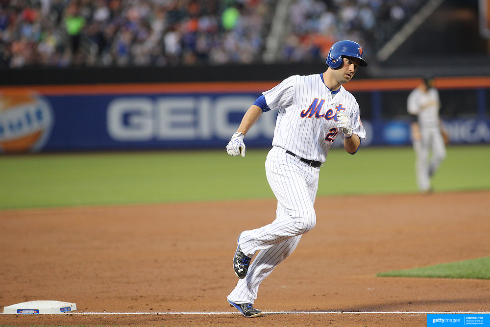 NEW YORK, NEW YORK - June 16: Neil Walker #20 of the New York Mets runs the bases after hitting a home run in the third inning during the Pittsburgh Pirates Vs New York Mets regular season MLB game at Citi Field on June 16, 2016 in New York City. (Photo by Tim Clayton/Corbis via Getty Images)