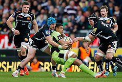 Northampton Inside Centre Luther Burrell is tackled by Exeter Chiefs Outside Centre Jack Nowell - Photo mandatory by-line: Rogan Thomson/JMP - 07966 386802 - 11/04/2015 - SPORT - RUGBY UNION - Exeter, England - Sandy Park Stadium - Exeter Chiefs v Northampton Saints - Aviva Premiership.