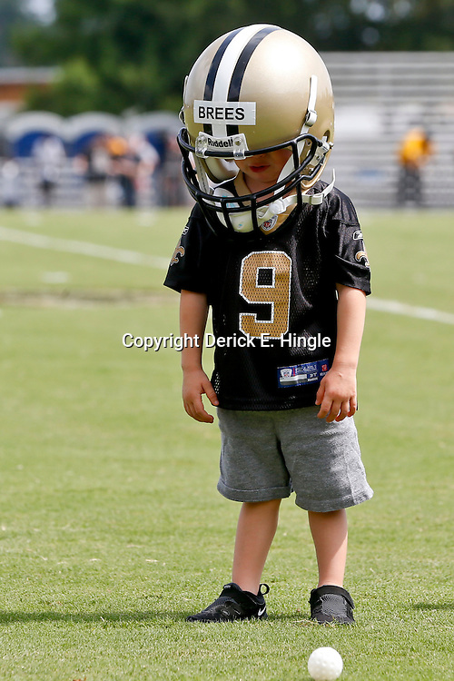 Aug 3, 2013; Metairie, LA, USA; New Orleans Saints quarterback Drew Brees son Bowen Brees wears his dad's helmet following a scrimmage at the team training facility. Mandatory Credit: Derick E. Hingle-USA TODAY Sports
