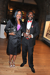 TASHA DANVERS British Olympic bronze medallist, who finished in third place in the 400 metres hurdles at the 2008 Beijing Olympics and LEVI ROOTS Celebrity chef and inventor of Reggae Reggae sauce at the annual Chain of Hope's annual Gala Ball held at the Natural History Museum, London on 8th November 2012.