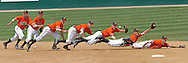 Photo Illustration of Oklahoma State shortstop Chris Gutierrez diving for a sharp ground ball hit up the middle against Kansas State at Tointon Stadium in Manhattan, Kansas.