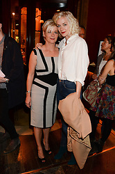 PORTIA FREEMAN and her mother LIZ STONE at Models and Mothers Private View, a photographic exhibition in aid of Breakthrough Breast Cancer held at The Gilbert Scott, St Pancras Renaissance Hotel, London, NW1 on 7th October 2013.