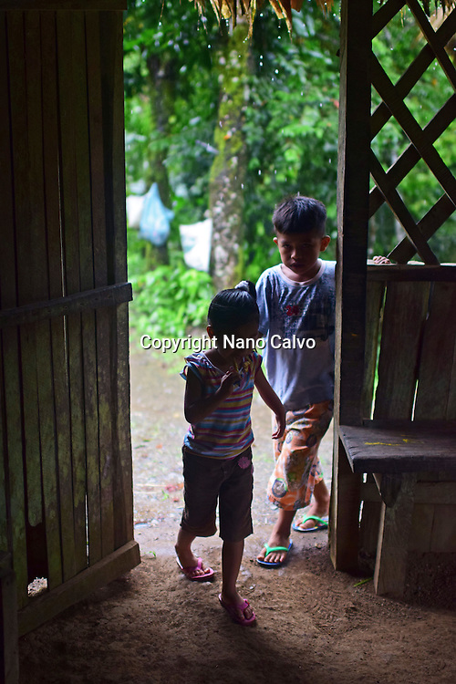 Dereck and Karen enter cottage to cover from the rain.<br /> <br /> A day with the Bribri, indigenous people in Lim&oacute;n Province of Costa Rica