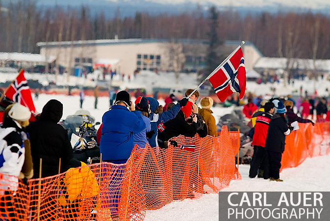 05 March 2006: Willow, Alaska - Fans wave Norwegian flags in support of the three mushers competing from Norway during the restart of the 2006 Iditarod on Willow Lake in Willow, Alaska