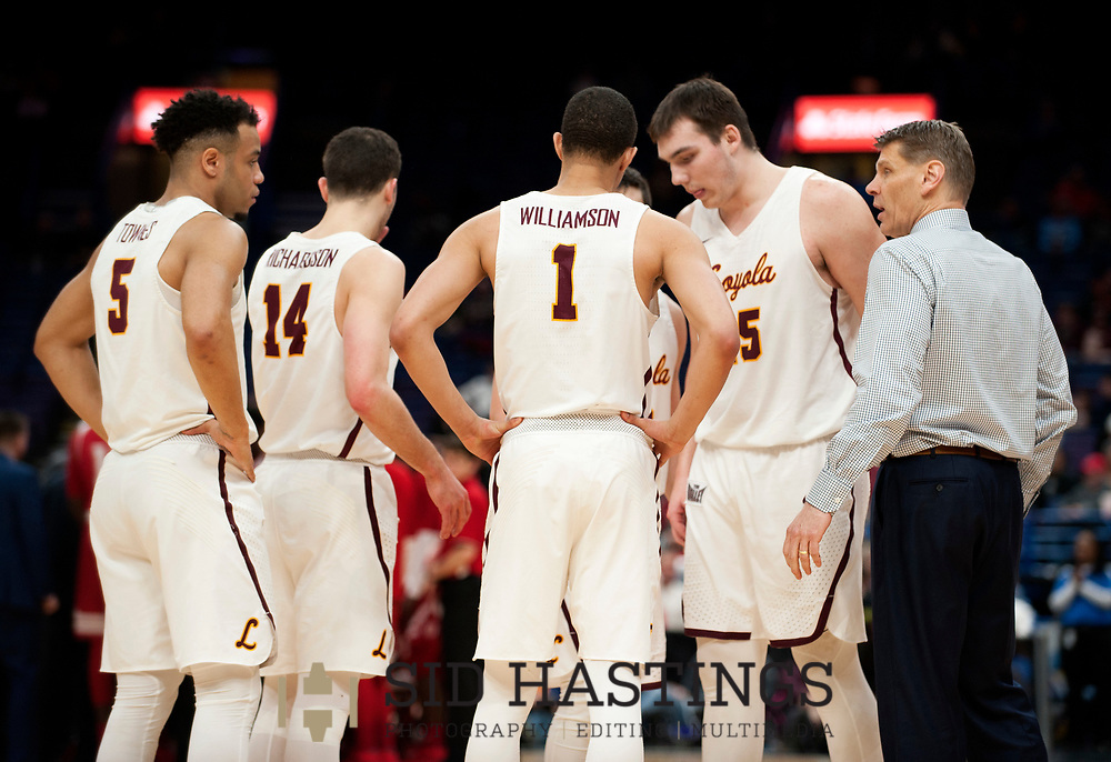 Loyola University Chicago basketball coach Porter Moser gathers his team during a timeout against Bradley University during the semifinals of the Missouri Valley Conference men's basketball tournament at Scottrade Center in St. Louis Saturday, March 3, 2018. Photo © copyright 2018 Sid Hastings.