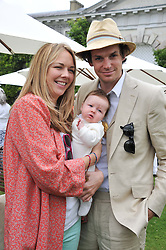 TOR COOK, HUGO HEATHCOTE and their daughter LOLA at a luncheon hosted by Cartier for their sponsorship of the Style et Luxe part of the Goodwood Festival of Speed at Goodwood House, West Sussex on 1st July 2012.